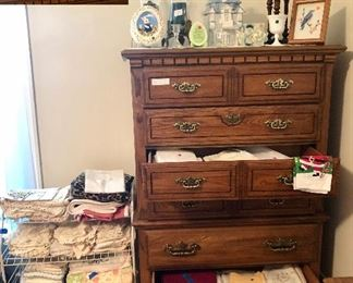 Stanley 6 drawer chest, small shelf is full of crocheted doilies and photo albums
