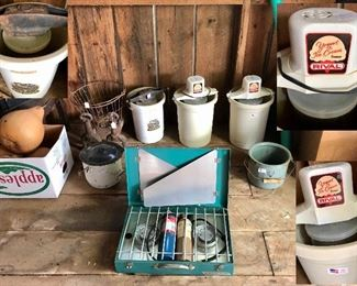 Propane cook stove, white/blue chamber pot, vintage nursery diaper pail, andirons, vintage ice cream churns ( cast iron hand churn, 2 electric Rival yogurt/ice cream freezers)