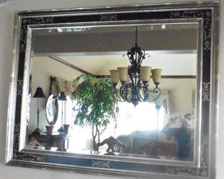 "Framed, beveled wall mirror. 58""wide x 46"" high. $175"