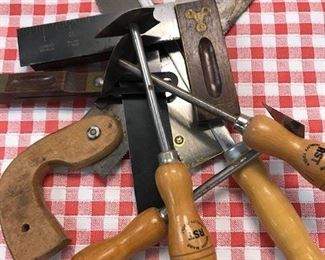 Assorted tools with wooden handles.