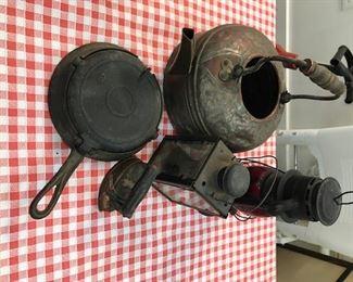 Vintage lanterns, griddle and teapot.