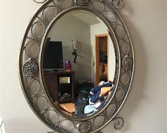 "Decorative mirror, 50""H x 32""W,   $65"
