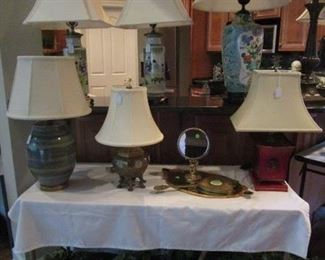 Assorted Lamps from all over the world.  Assorted of Basked with greenry,  Antique Make-up Mirror.