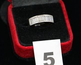 #G5   Ladies 18kt. white gold band with 7 baguettes in size 7 1/2.  Too fabulous   $2,800.00