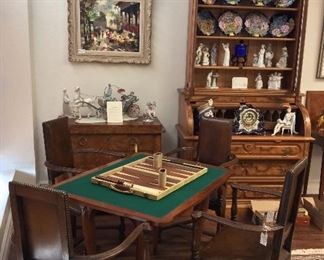 Game Table. Four Leather Arm Chairs.