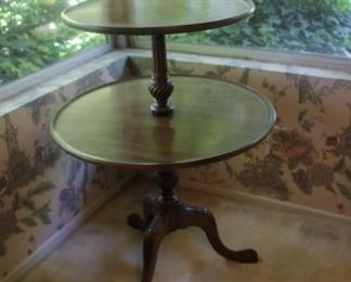 """#3.  $60.00.   Butler/tea time table two tier tri footed leg. 32"""" x 24"""" round."""