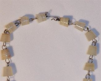 "Hand made natural stone necklace with carved pendant.  24.5"" long, pendant adds additional 2"".   $6 (was $10)"