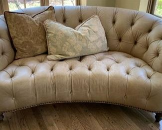104. Tufted Leather Loveseat (74'' x 36'' x 32'') $ 400.00