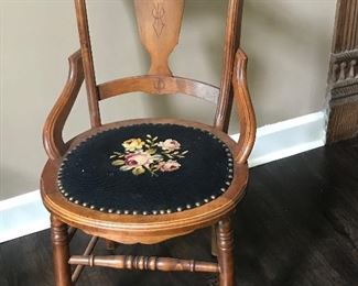 antique chair with a later needlepointseat