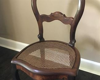 antique rosewood chair with a caned seat