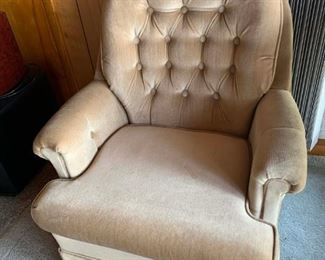Tan velvet upholstered swivel chair. Solid and clean.