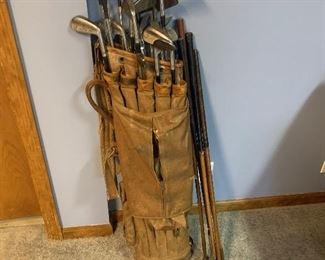 Antique golf clubs, including hickory.