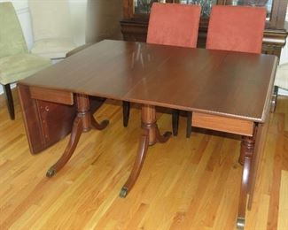Beautiful dropleaf walnut dining table with 8 chairs.