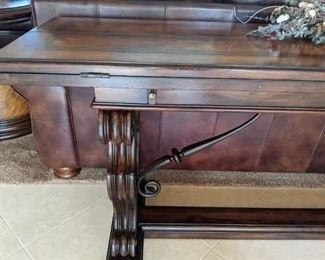 Expandable Table by Thomasville Walnut stain .  This can be a sofa table , buffet table, and then in a min you can expand this to a dining room table Sorry not chairs.  Very Different piece great for a small kitchen / room start price $300