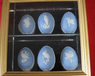 $50. Set of 6 Wedgwood Blue eggs in a gold colored shadow box. 9x9. Black felt shelf and mirrored shelf.
