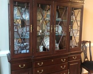 $950 - Stunning Kincaid mahogany breakfront with Chippendale-style fretwork, brass hardware and lighted interior and silver drawer. Great storage!