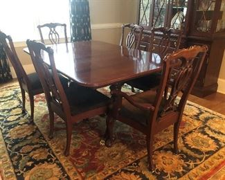 $2,800/all - Exquisite Kincaid solid mahogany oval dining table with set/6 Chippendale-style chairs; double pedestals with brass claw feet; two leaves and custom pads. Rug not included in sale.