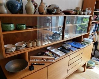 Danish Modern Credenza/Curio/Gallery Cabinet. Lots of wonderful handmade and Asian Pottery.