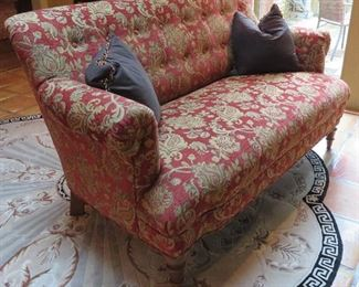 Gorgeous settee with accent pillows