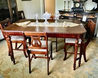 Another view of the area rug and dining table.
