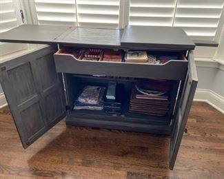 """SCHEDULE AN APPOINTMENT TO VIEW IN PERSON ....Interior shot of beautiful oak bar or serving buffet on casters with a slate top. It's a stunning slate grey that will blend in easily with your decor.  See previous picture for general shot. Vintage, circa 1960s, 30 1/2""""H, 36""""W, 18""""D - $450. Picture 2 of 2."""