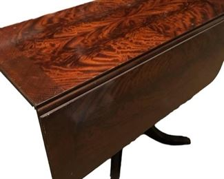 """SCHEDULE AN APPOINTMENT TO VIEW IN PERSON this Circa 1930s antique Duncan Phyfe - style drop leaf pedestal table. Closed dimensions: 17 1/2""""W x 38""""D 29 1/2""""H.  Open dimensions: 45""""W x 38""""D.  At $385, it's a steal! To view it open or for a close up of the pedestal, please see the next two pictures. Picture 1 of 3."""