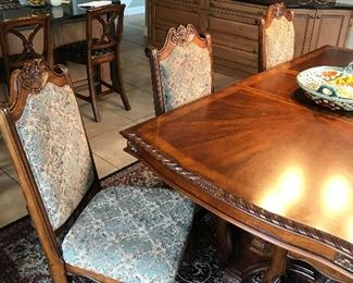 One of eight matching dining room table chairs