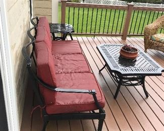 3 pc aluminum  patio set including couch with cushions, coffee table, and end table