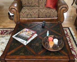 Love seat and coffee table which are part of a four piece living room set