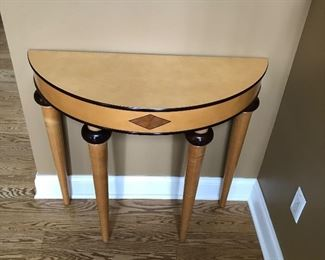 Blonde half round entry table which has a matching mirror