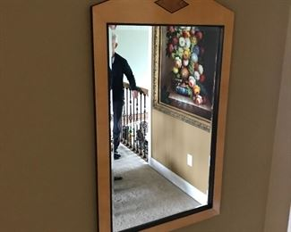 Blonde mirror which is part of a set that includes a matching half round entry table