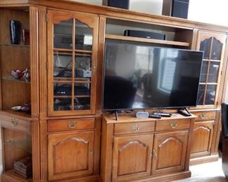 Thomasville entertainment center--this center has two end caps that can be used as corner cupboards $195 for three middle parts $95 each for the corner cabinets. TV is sold.