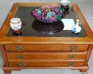 The top drawer on this glass top coffee table can be used to display your special collection. The two other drawer are available for more storage. $200