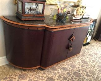 Stylish Hutch with tri colored wood inlay and a granite top.