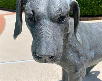 $1,000 life size bronze dog.  Artist unknown.