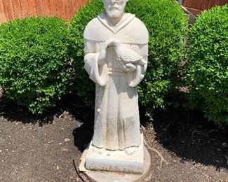 $100 - Large outdoor stone sculpture of St. Francis.