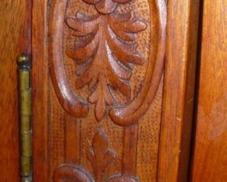 CARVINGS ON DOORS OF CHEERY CABINET