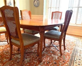 "Beautiful Henredon dining table w/6 cane back chairs,    2 leaves and pads  $1600.00  30""h X 43""w X 65""          each leaf 20""w"