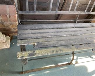 missing piece on iron and wood bench
