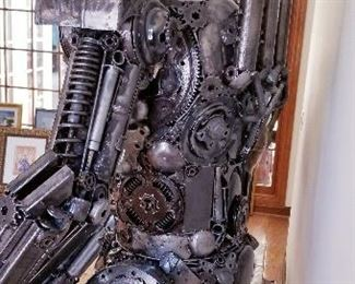 """LOT X- $22,000- Optimus Prime by Sculptor """" Mr. Santo"""" from Elena Bulatova Fine arts. This rendition is made out of recycled car and motorcycle parts  ( Approximately 84""""  tall x 5 ft wide x 38 """" deep). More info on artist can be found on https://www.elenabulatovafineart.com/mr-santo"""