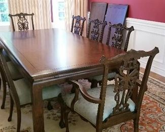 LOT D1- $2750- SPECTACULAR DINING TABLE WITH 8 SPECTACULARLY CARVED CHAIRS, 2 EXTENSION LEAVES THAT ALLOW YOU TO SIT UP TO 14 AND TABLE PADS FOR PROTECTION