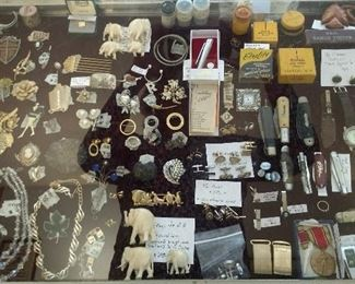 lots of costume jewelry, pocket knives, hand carved elephants brought home from Pacific theater after WW II