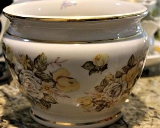 Hand painted floral china is exquisitely detailed.  With gold banding.