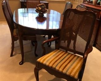 """Dining Room Table w/ 3 Leaves, Pads & 6 Caned Back Chairs - $200  68""""l  x  44""""w  x  29""""h, Leave 10"""" each"""