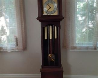 LR Grandfather Clock. Glass is broken out.