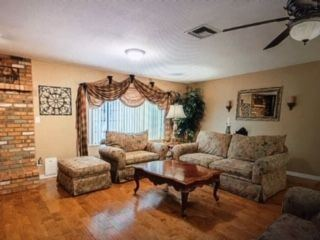 Family room different view, furniture, artificial tree, curtains
