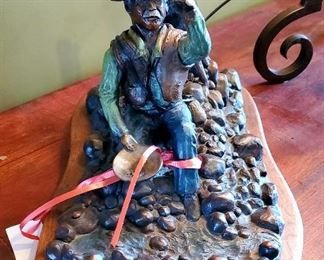 """""""Pay Day"""" bronze by Barry Wenger,  $1200.                 Retails for $3,000."""