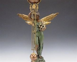 """A turn of the century Ansonia """"Gloria"""" model figural swinger clock.  8-day time only movement with ball top and grid iron pendulum.  Cast Spelter case with figure of a winged """"Gloria"""" on a Black base.  Nicely refinished with slight wear, running when cataloged.  28 1/2"""" high.   ESTIMATE $2,000-3,000"""