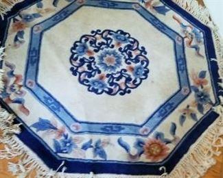 #46    floral octagon  chen chu rug  46 diameter. $40