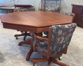 Flip top game table w/6 swivel chairs  $1140.